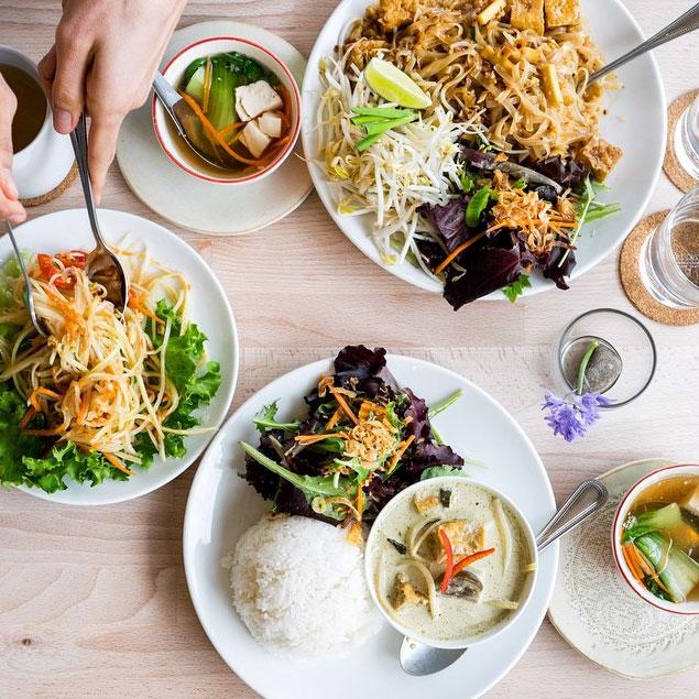 Plates full of Filipino dishes in Cincinnati